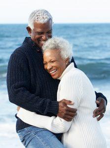 dental-implants-couple-beach-river-dental-ar