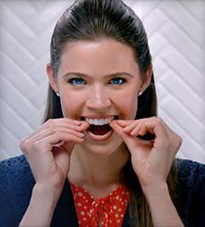 Invisalign®-girl-putting-in-river-dental-springdale-ar
