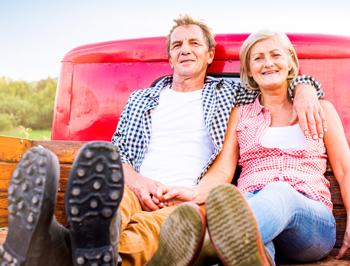 dental implants-couple-truck-river-dental-ar